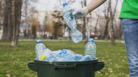 Volunteer-putting-plastic-bottles-bin_23-2147807266_thumb_main